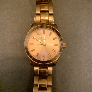 Kenneth Cole rose gold wrist watch for women.